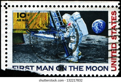 USA - CIRCA 1969: A stamp printed in United States of America shows Neil Armstrong's first step on the moon, circa 1969