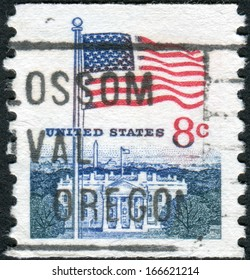 USA - CIRCA 1971: Postage stamp printed in the USA, shows the national flag and White House, circa 1971