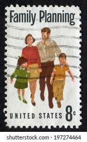 USA- CIRCA 1972: Postage stamp printed in United States of America shows  Family (Father, Mother, Daughter, Son). Scott Catalog A869 1455 8c, circa 1972