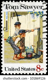 """USA - CIRCA 1972: A stamp printed in USA shows the painting """"Tom Sawyer"""", by Norman Rockwell (1894-1978), American Folklore Issue, circa 1972"""