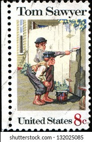 """USA -CIRCA 1972: A stamp printed in United States of America shows painting """"Tom Sawyer"""" by Norman Rockwell (1894-1978), Circa 1972"""