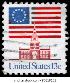 USA - CIRCA 1975: A Stamp printed in USA shows the 13-Star Flag, Independence Hall, circa 1975