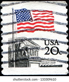 USA - CIRCA 1981: A stamp printed in United States of America shows flag and the Supreme Court, circa 1981