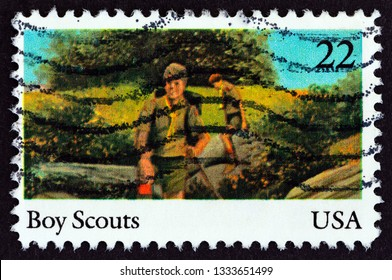 """USA - CIRCA 1985: A stamp printed in USA from the """"International Youth Year""""  issue shows boy scouts, circa 1985."""