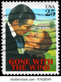 """USA - CIRCA 1990: A stamp printed in USA shows Clark Gable and Vivien Leigh (Gone with the Wind), """"Classic Films"""" series, circa 1990"""