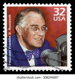 USA circa 1998: Issued by USPS in 1956 shows Former US president Franklin D. Roosevelt (1882-1945) before Microphone, who won four elections and served from March 1933 to his death in April 1945.