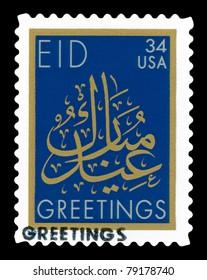 USA - CIRCA 2001-  Eid Mubarak American stamp with gold Arabic calligraphy. The design is by Mohamed Zakariya, circa 2001.