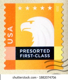USA- CIRCA 2015: A postage stamp printed in the United States of America shows Bald Eagle USPS Emblem and 5 stars. Orange, yellow, circa 2015