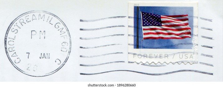USA - CIRCA 2019: part of envelope with a postage mark wave, round postal mark and a stamp printed in the USA with  the Flag of the United States.  - Forever, circa 2019