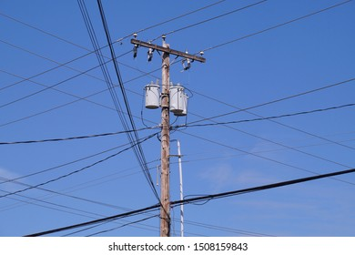 USA. Classic wooden pole with electrical installations.  Oil transformers. If mounted on a utility pole, they are called pole-mount transformers.