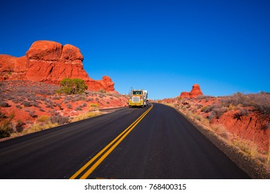 USA. COLORADO. ARCHES NATIONAL PARK. NOVEMBER 2017: Endles road, Road through the mountains with a truck.