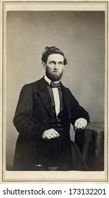 USA - CONNECTICUT - CIRCA 1865 - A vintage Cartes de visite photo of a gentleman. The man is sitting with one arm on a table. A photo from the Civil War Victorian era. CIRCA 1865