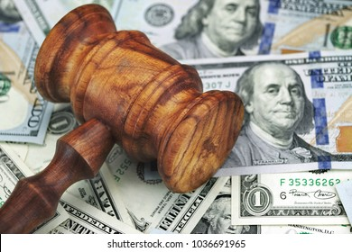 USA Dollar Cash And Auctioneers Or Judges Gavel Or Hammer On Wooden Courtroom Bench Or Auctioneer Table. Wood Background. Law, Monetary, Auction Bidding, Bankruptcy, Bail, Tax Concept. Top View.