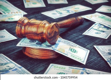 USA Dollar Cash And Auctioneers Or Judges Gavel Or Hammer On Wooden Courtroom Bench Or Auctioneer Table. Wood Background. Law, Monetary, Auction Bidding, Bankruptcy, Bail, Tax Evasion Concept.