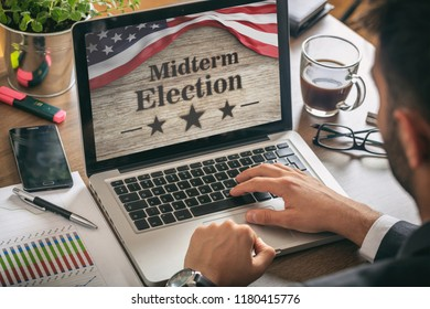 USA electronic vote concept. Businessman with a US of America midterm elections picture onscreen