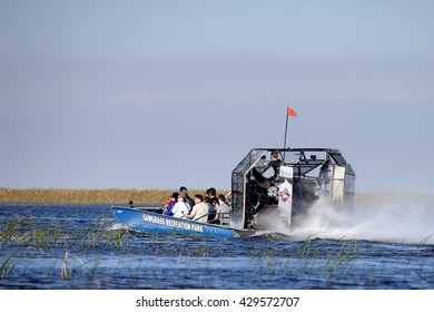 USA - February 13, 2016: Tourist enjoying and airboat ecotour of the Sawgrass Recreation Park in the National Everglades Park near Weston, Florida on February 13, 2016.