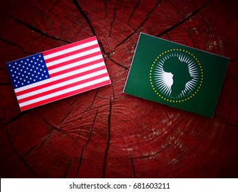 USA flag with African Union flag on a tree stump isolated