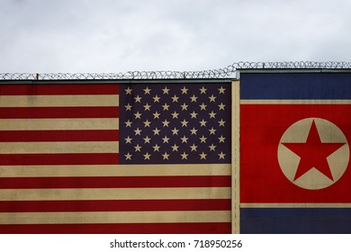 USA flag against North Korea on a prison wall