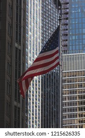 USA flag, commercial buildings on background, skyscraper background/