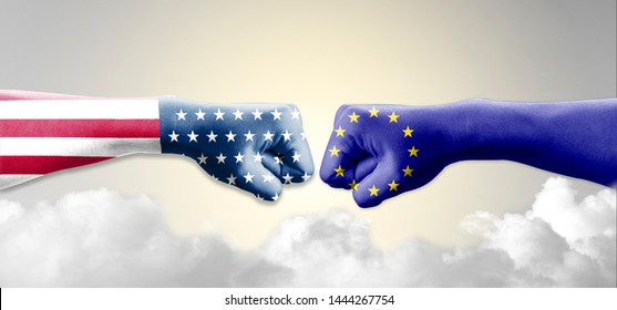 USA flag and EU flag print screen on two  fists  for battle.It is symbol of United States of America increase tariff tax barrier for import product from EU countries.-Image.