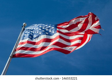 A USA flag flies in a strong wind in Louisiana, USA