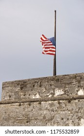 USA flag at half mast.