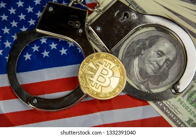 USA flag with handcuffs and a bundle of dollars and bitcoin. Currency corruption in the country. Financial crimes