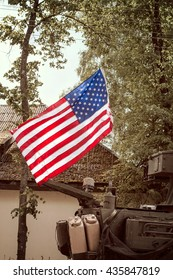 USA flag mounted on Military Army Stryker light armored brigade vehicle
