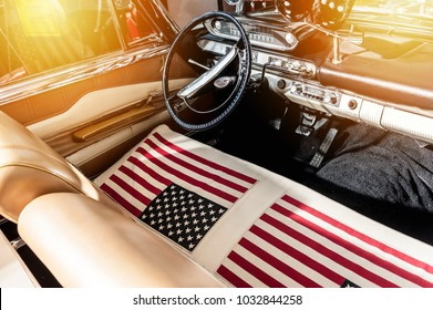 USA flag on seat of a car with sunlight