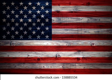 USA flag on a weathered natural wooden wall close-up