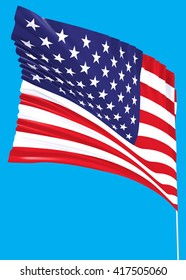 USA flag on the wind with a blue sky