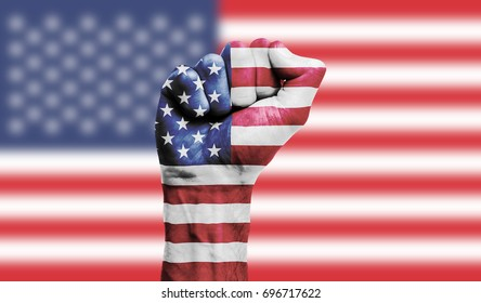 USA flag painted on a clenched fist. Strength, Power, Protest concept