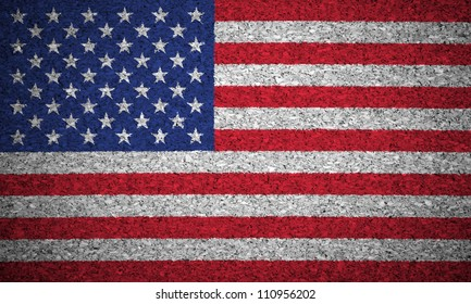 The USA flag painted on a cork board.