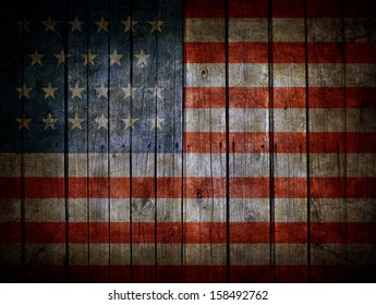 USA flag painted on dark wooden background