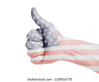 USA flag painted on hand showing thumbs up