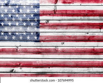 The USA flag painted on wooden fence
