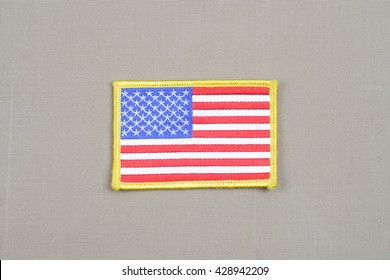 USA flag patch on desert camouflage uniform