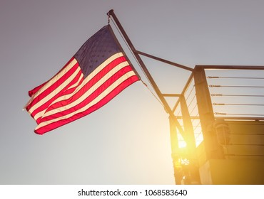 USA flag, scanning from the stern of a ship, during sunset, in New York