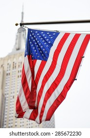 USA flag with skyscraper on background
