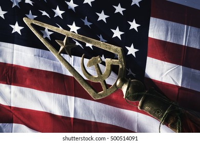 usa flag and soviet symbol. hammer with sickle