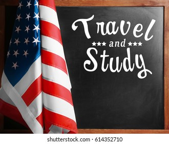 USA flag and text TRAVEL AND STUDY on blackboard background