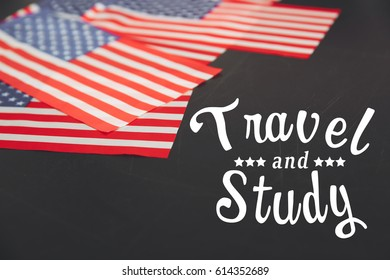 USA flags and text TRAVEL AND STUDY on blackboard background