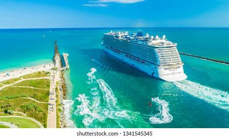 USA. FLORIDA. MIAMI BEACH 2019: Cruise ship Norwegian Bliss entrance to Atlantic ocean.