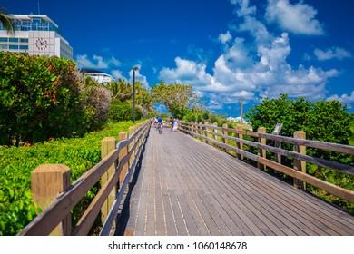 USA. FLORIDA. MIAMI BEACH, APRIL 2018: Walkway to famous South Beach, Miami Beach, Florida. USA