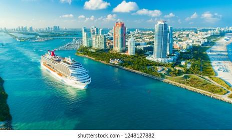 USA. FLORIDA. MIAMI BEACH. DECEMBER, 2018: Cruise ship (Carnival Magic) entrance to Atlantic Ocean, from Miami port.