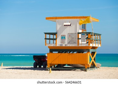 USA, FLORIDA, MIAMI BEACH. JANUARY 25, 2017. Lifeguard tower in a colorful Art Deco style, with blue sky and Atlantic Ocean in the background. World famous travel location. South Beach.