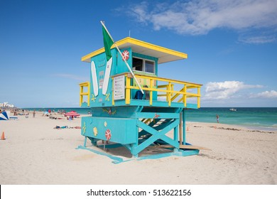 USA, FLORIDA, MIAMI. NOVEMBER 10, 2016. Lifeguard tower in a colorful Art Deco style, with blue sky and Atlantic Ocean in the background. World famous travel location. South Beach. Editorial use only