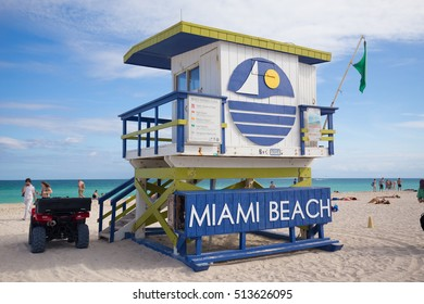 USA, FLORIDA, MIAMI. NOVEMBER 10, 2016. Lifeguard tower in a colorful Art Deco style, with blue sky and Atlantic Ocean in the background. World famous travel location. Miami Beach. Editorial use only