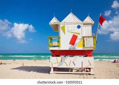 USA, FLORIDA, MIAMI. NOVEMBER 2, 2016. Lifeguard tower in a colorful Art Deco style, with blue sky and Atlantic Ocean in the background. World famous travel location. South Beach. Editorial use only