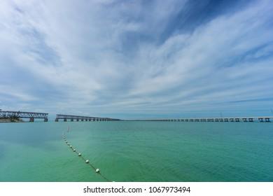 USA, Florida, Old overseas railway bridge next to new overseas highway road in tropical ocean water